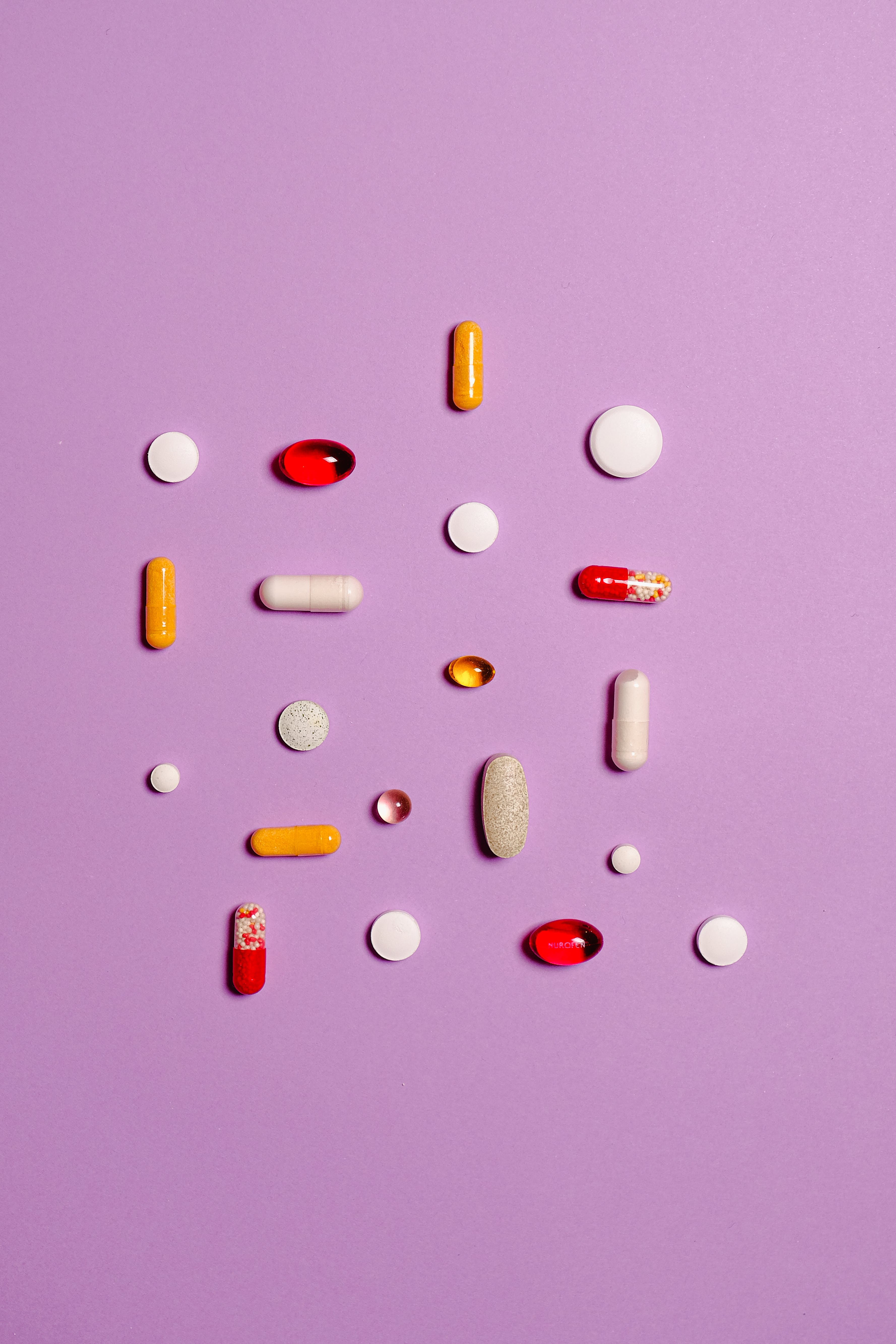 Medication Pills Isolated on Purple Background